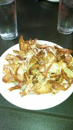 La Merenda : Truffles potato skins and braised veal. Both good nice hold me over b4 dinner.