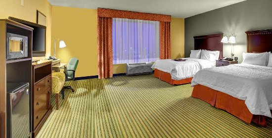 Tamarac, FL: Our spacious room features two queen-sized beds, flat-screen TV, alarm clock/radio and free WiFi