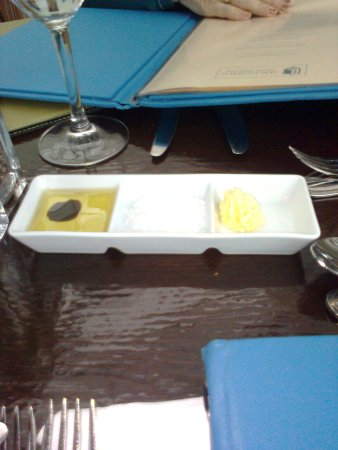 The tray served with the bread in the main restaurant at dinner with oil/vinegar, salt & butter
