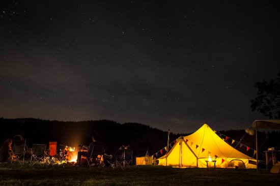 Llandegla, UK: The Wedding Party around the camp fire! P: Jamie Harper