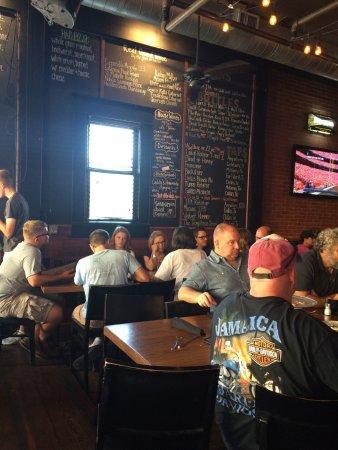 McKinney, TX: Seating & beer menu on the wall