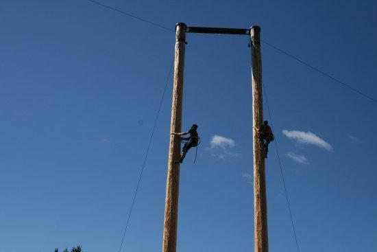 North Vancouver, Canada: Lumberjacks climbing 60 feet poles