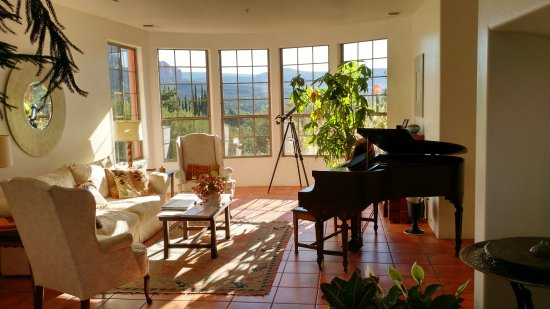 The Penrose B&B: The common living room is shown with piano, telescope and tasteful decor.