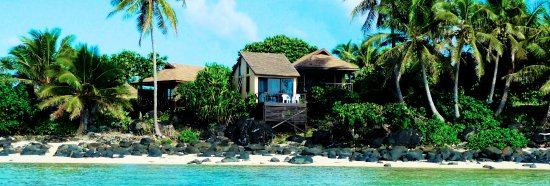 Muri Beach Cottages: View of The Cottages and The Pole House ~ from the lagoon