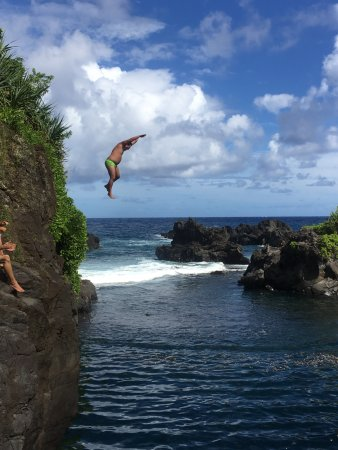 No Ka Oi Private Adventures : Cliff jumping into a beautiful deep pool in a cove past Hana