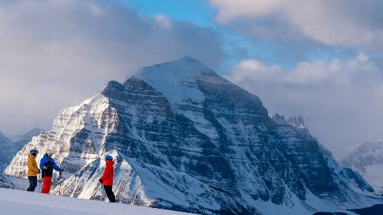 Skiing the Lake Louise Ski Resort with Mt. Temple in the background