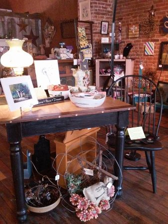Prairie du Chien, WI: Hand crafted table and paintings by local artists with a variety of vintage items.