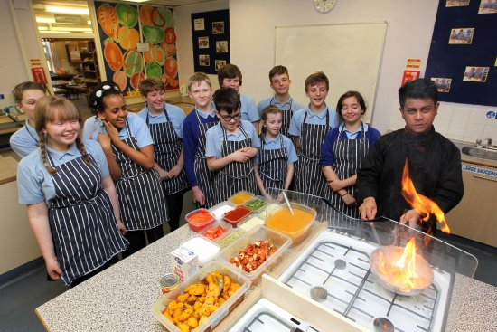 Royston, UK: Safwaan Choudhury leading a culinary class for pupils at Roysia Middle School