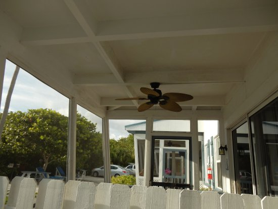 shared porch with divider Picture of Tropical Winds Motel