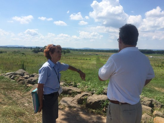 Association of Licensed Battlefield Guides: Susan explaining The High Water Mark of Pickett's Charge.