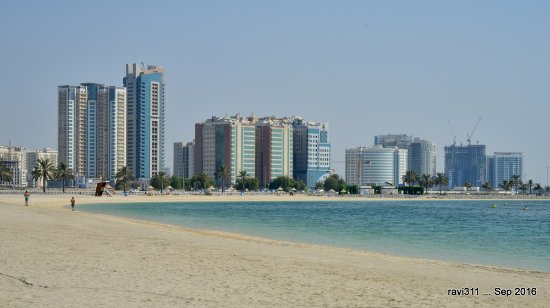 Al Mamzar Beach Park With The Backdrop Of Modern Buildings