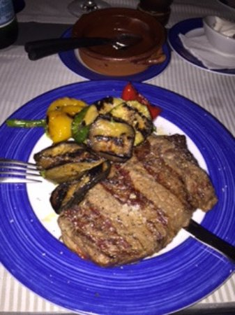 "Cala Blava, Spanien: ""Grilled Entrecote , grilled vegetables with pesto dressing, pommes frites cooked in olive oil ."