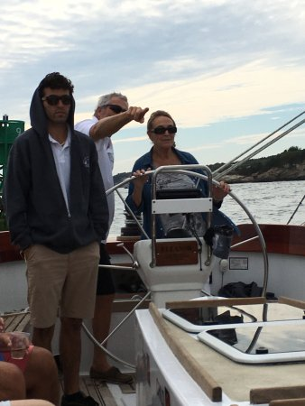 Sailing Excursions Adirondack II: Captain John explaining point of interest. First Mate Connor ready to lend a hand.