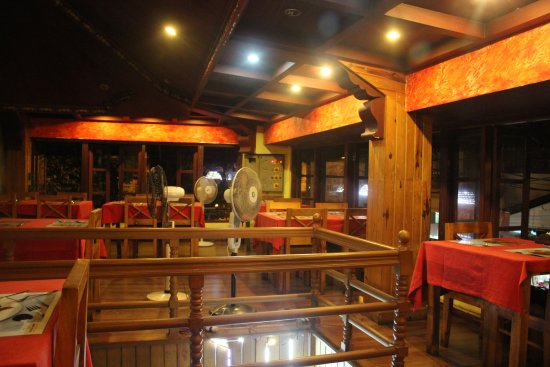 Masala Fort : Wooden interior decor, warm lights, and a heritage touch