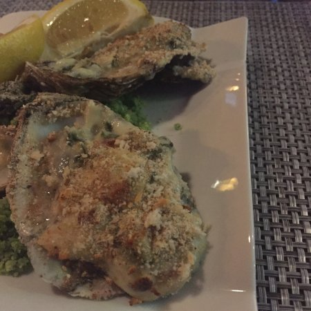 Springfield, MA: Delicious Oysters Rockefeller appetizer; steak with bone marrow entree