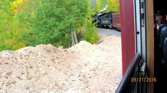Antonito, CO: This shows train from our sitting area as it rounds the bend.