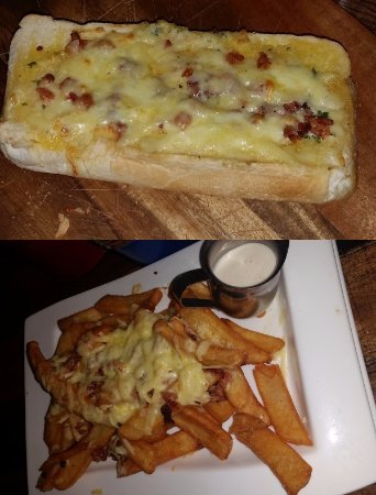 Shellharbour, ออสเตรเลีย: Cheesy bacon garlic bread top, Amarillo cheese fries bottom.