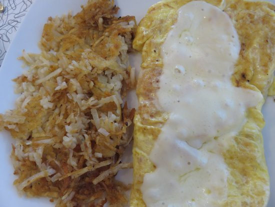 Port Orange, FL: Tomato-provolone omelet with hash browns
