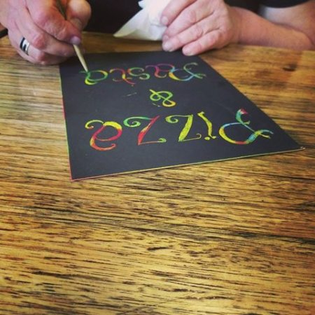 Creswick, Australia: The owner hard at work! These scratch art sheets are provided free when families dine in.