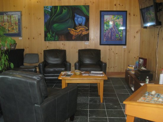 Queen Charlotte City, Canada: Comfy lounge area inside the Centre with local art displayed.