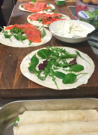 Laukvik, Norway: Preparation of tortillas with smoked salmon, cream cheese and salad.