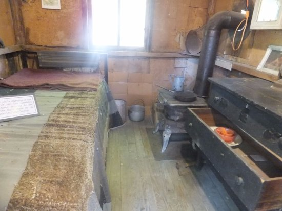 Tom Cassidy's house (a batchelor) A cot, a chair, stove,frying pan ,old dresser,fiddle and pisto