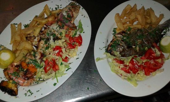 Poros, Greece: shrimps souvlaki and grilled sea bream
