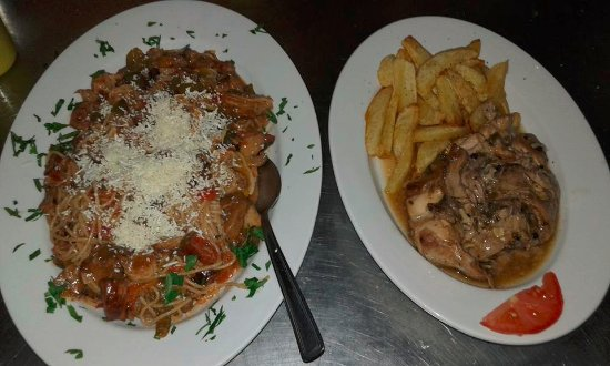 Poros, Greece: traditional rabbit in lemon and spaghetti with sea food