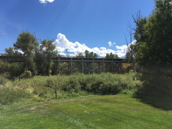 Eagle, CO: Old train trestle bridge viewed from Tourist Center park behind barn