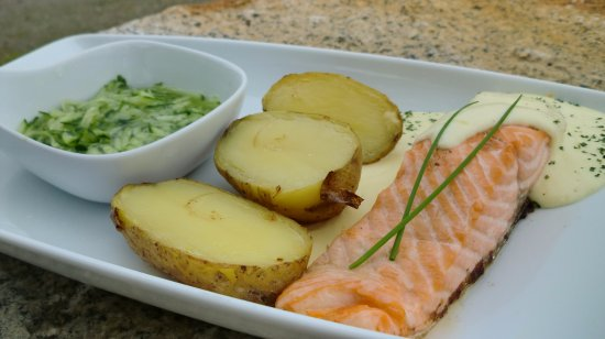 Laukvik, Norway: Fresh trout served with cucumber salad, good creamy sauce and potatoes.