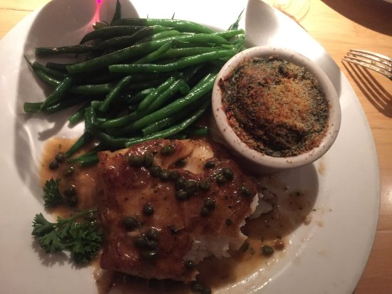 Juno Beach, FL: Chilean Sea Bass Picatta with Spinach side dish