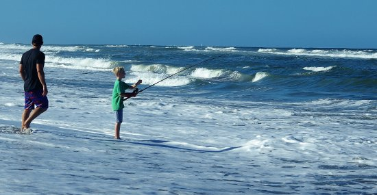 Hobe Sound, FL: FATHER TEACHING HIS SON SURF FISHING
