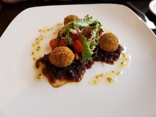browns restaurant at nevis bank inn breaded vegetarian haggis bon bons served on an onion