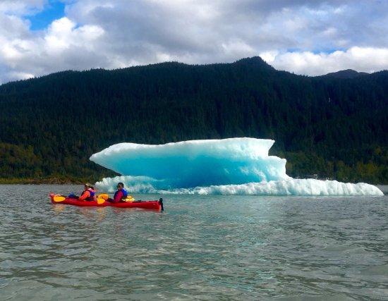 Above & Beyond Alaska: kayaking by an iceberg, like ya do.