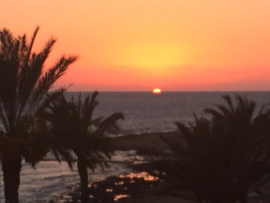 Constantinou Bros Athena Beach Hotel: sunset viewed from the balcony of our room - never get tired of that view.