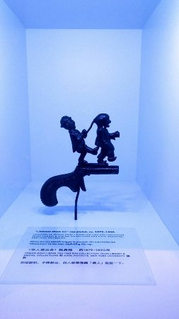 Museum of Chinese in  America: cap gun: Chinese must go, one of the relatively few non-print artifacts in the museum