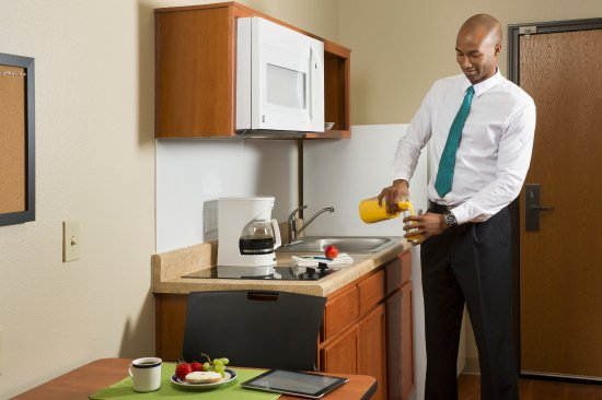 WoodSpring Suites Austin Aquarium: Dishes, Coffee Makers, and Silverware Available for a Small Cost.