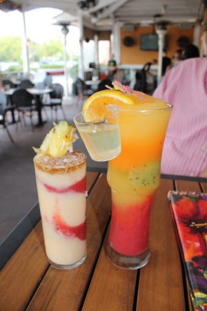 Brandon, FL: Ultimate Pina Colada with the pineapple and the Bahamarita with the shot glass and orange.