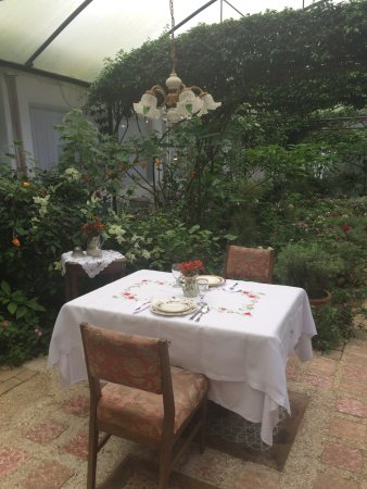 "Sonya's Garden B&B: Dining table in the screened off ""Proposal Garden"""
