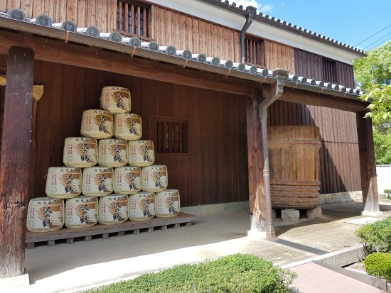 Kobe - Sawanotsuru sake brewery entrance with barrels of sake to welcome you.