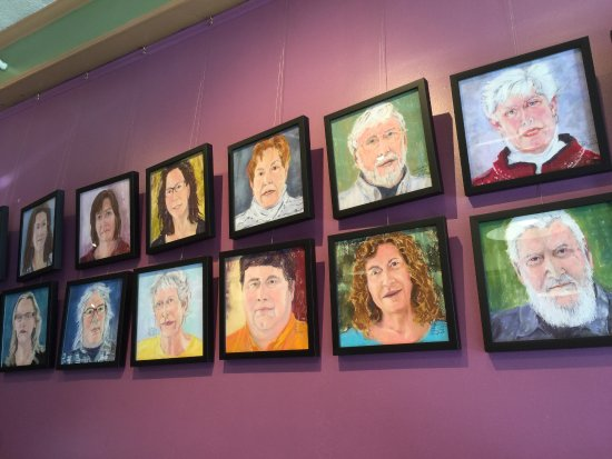 "Blue Moon Cafe : The wall of photos of local Saranac Lake people, ""Face to Face"" by Diane Leifheit."