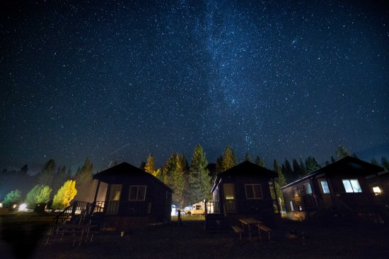 Yosemite Lakes RV Resort: Milky Way above the campground (sleeps 4 cabin pictured)