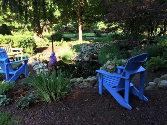 Jonesville, MI: Pond and sitting area in the garden
