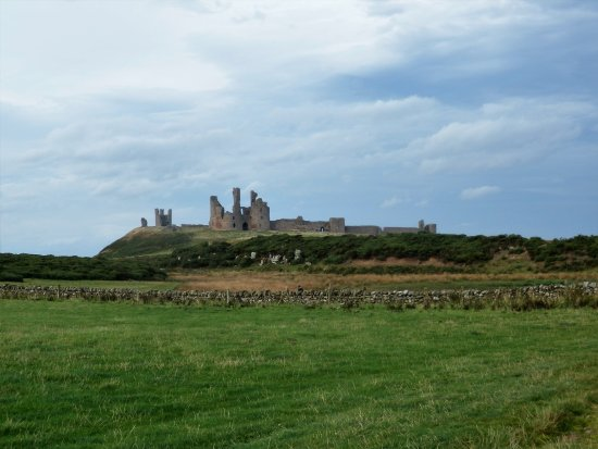 Craster, UK: View of Dunstanburgh Castle from a distance.