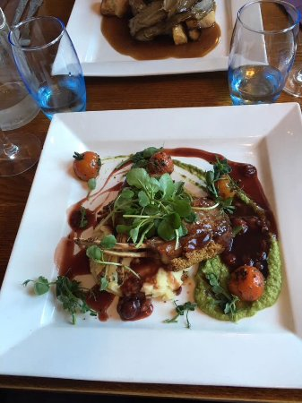 Southwell, UK: Rack of Lamb and goats cheese mash served with a cherry and port jus.