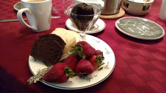 Whitehall, MI: Breakfast appetizer of chocolate zucchini bread, yogurt bread, strawberries and chocolate spread