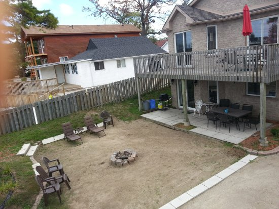 Wasaga River Resort Inc: Private waterfront patio, sundeck and campfire pit.