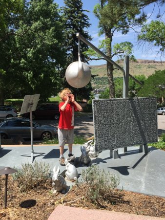Golden, CO: Summer camper interacting with our sculpture garden!