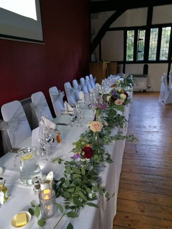 The Hospitium: Top table decorated for wedding breakfast