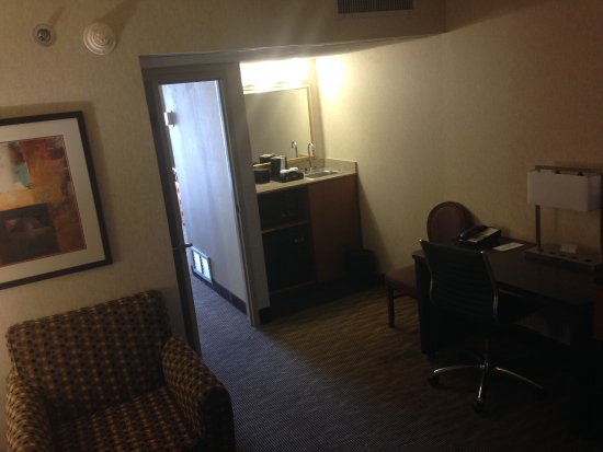 Embassy Suites by Hilton Oklahoma City Will Rogers Airport: From room entrance looking at bar area.